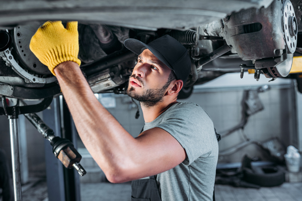 Man Working On Car - oil change in idaho falls