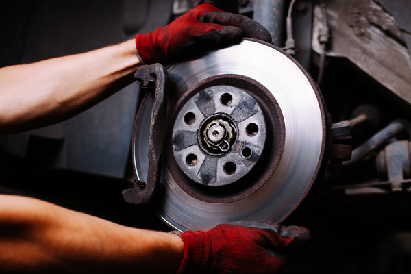 Man Working On Car Part - auto repair in idaho falls